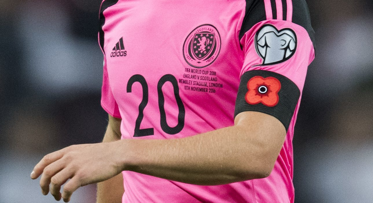 Scotland players joined England in wearing poppies on their armbands during the match.