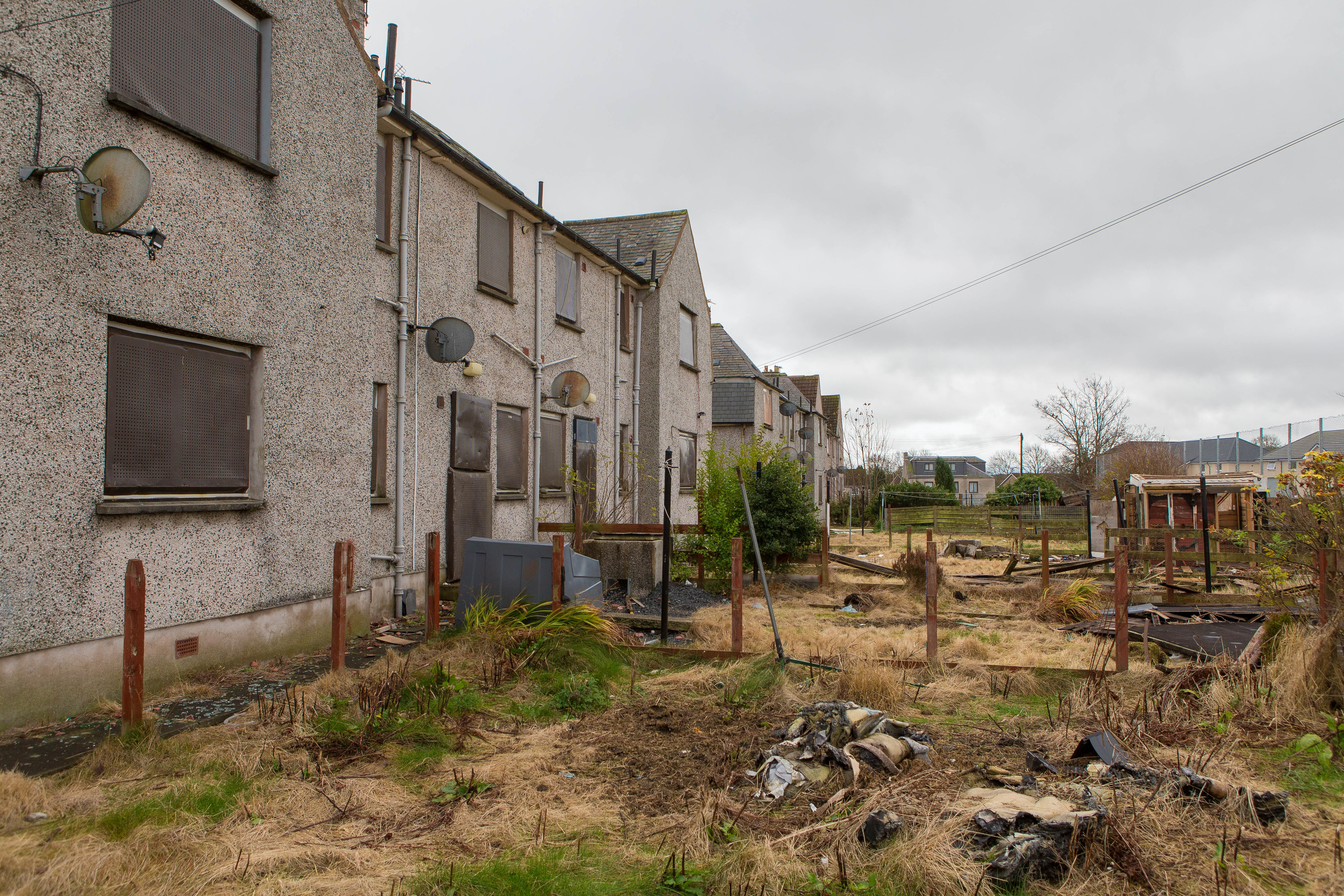 Derelict housing in Inchgall Avenue Crosshill is marked for demolition, but locals are concerned about the general state of the area in the meantime.