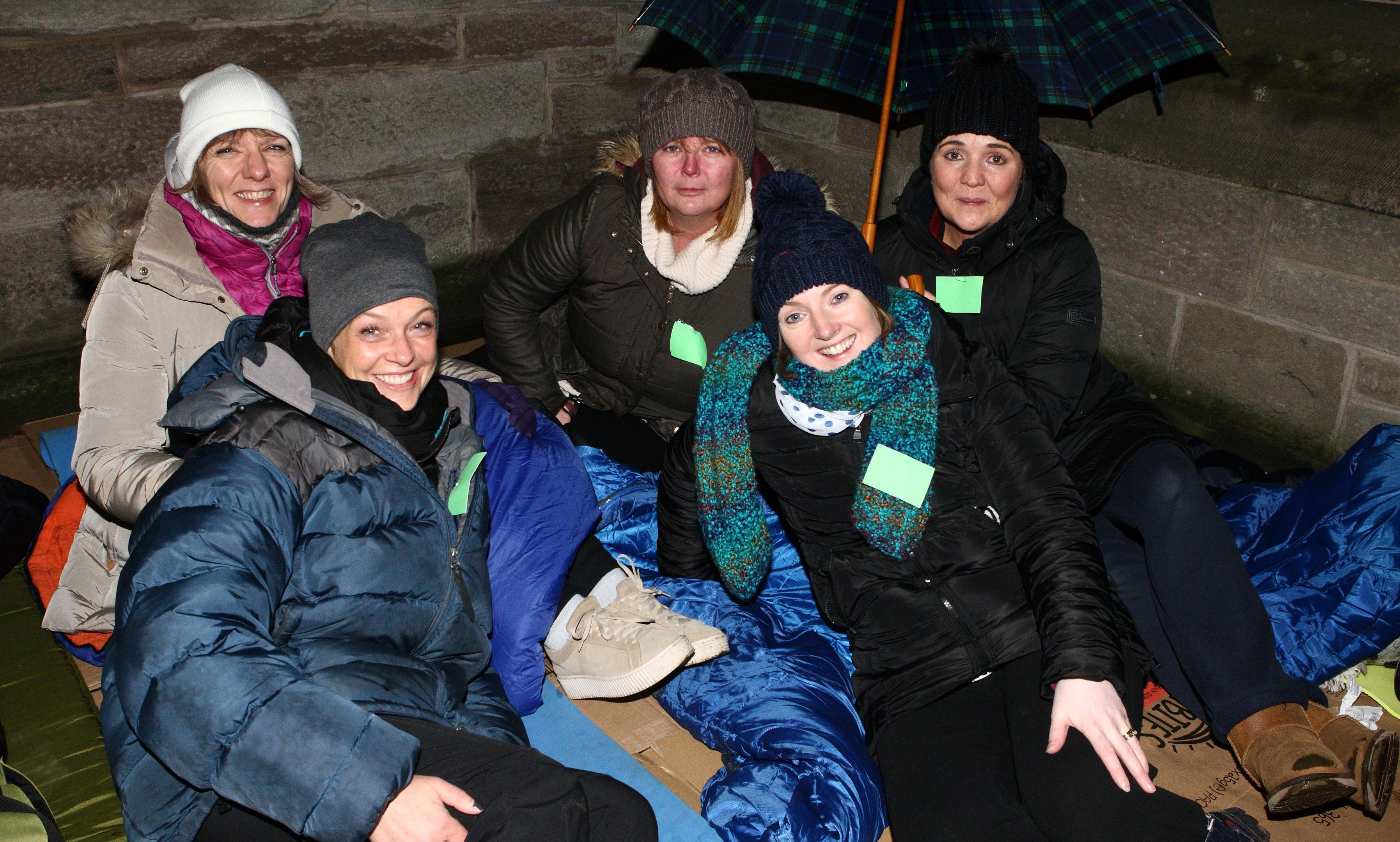 Clare Mailer, Lorna Cameron, Michelle Dow, Andrea McCallum and Elaine Ritchie sleeping outside St Johns Kirk in Perth.