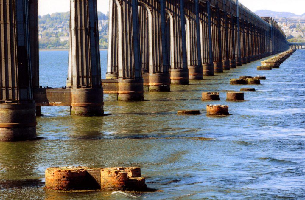 The stumps of the original railway bridge are reminders of the Tay Bridge disaster.