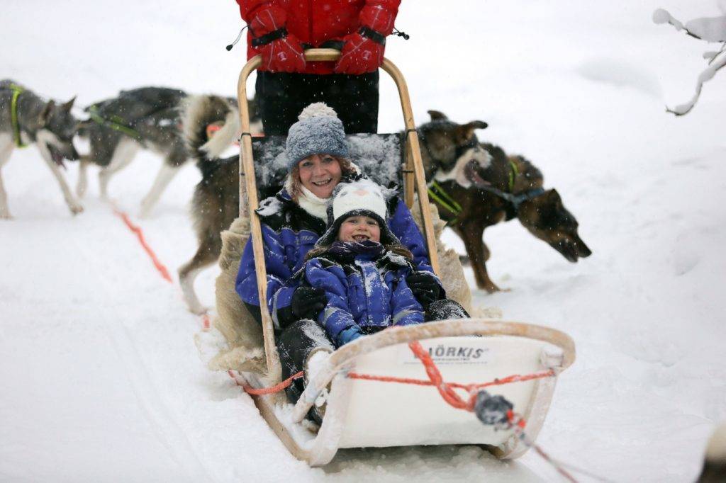 Claire Spreadbury and daughter Rosie on a husky ride.