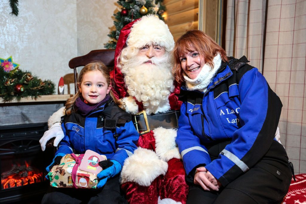 Claire Spreadbury and daughter Rosie with Santa.