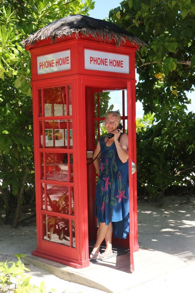 Karen in the complimentary phone box.