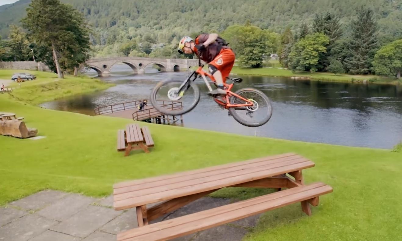 Danny MacAskill performs a bike stunt at Kenmore.