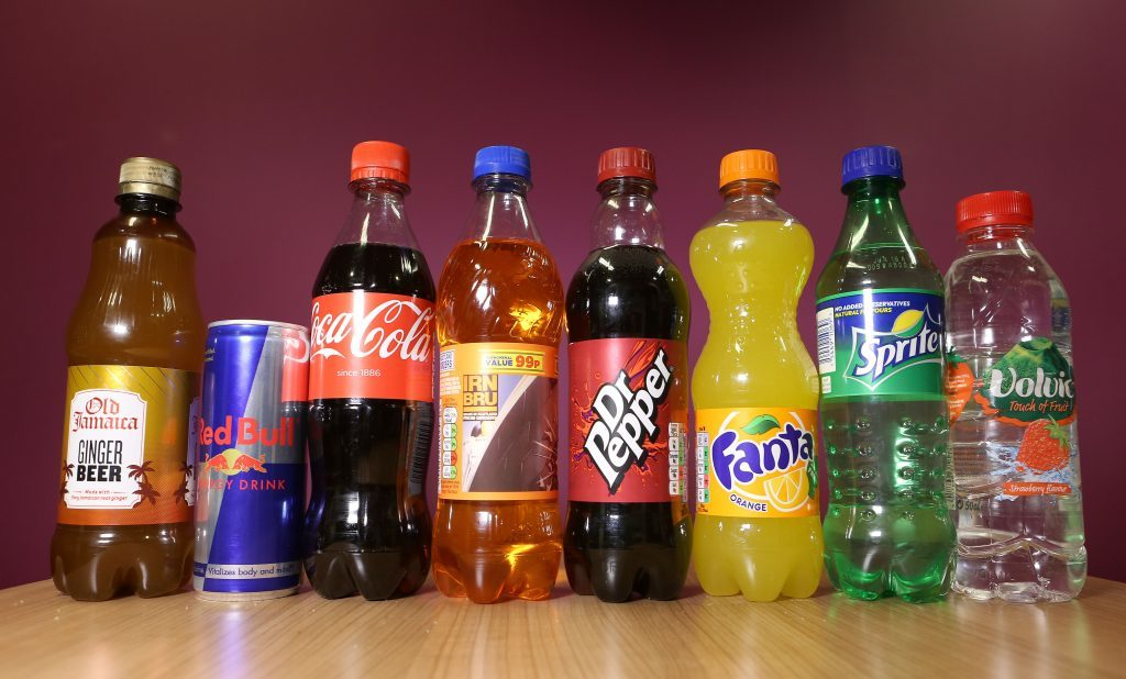 Bottles and cans of drinks which will be taxed on the amount of sugar they contain following the announcement of a tax on sugary drinks, unveiled by George Osborne as part of the Budget in March