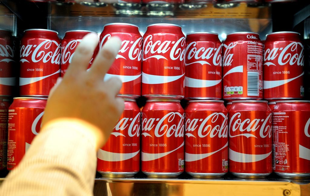 Cans of Coca-Cola which would currently fall within the higher rate of the sugar tax, following the announcement of a tax on sugary drinks, unveiled by George Osborne as part of the Budget last March.