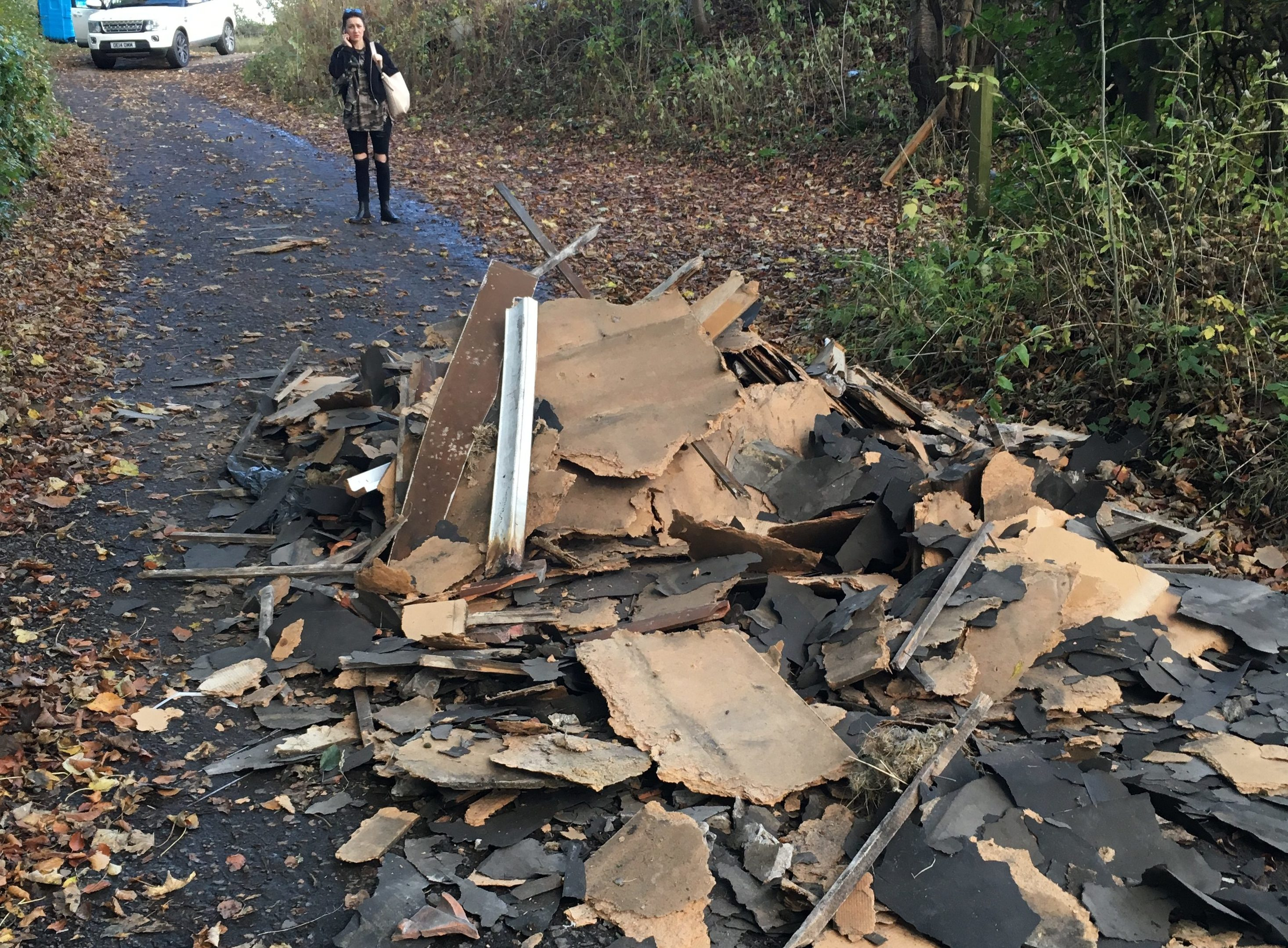 Nicola Gray examines the pile of rubble blocking her way home.