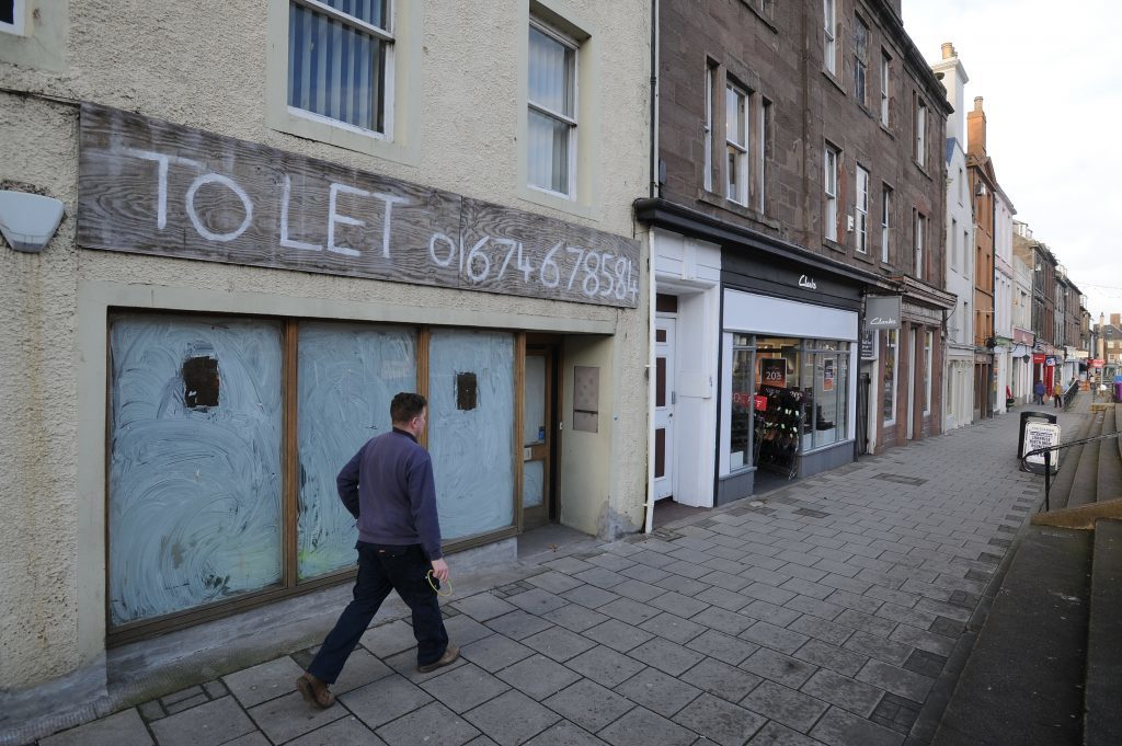 Boarded up shop in High Street, Montrose,