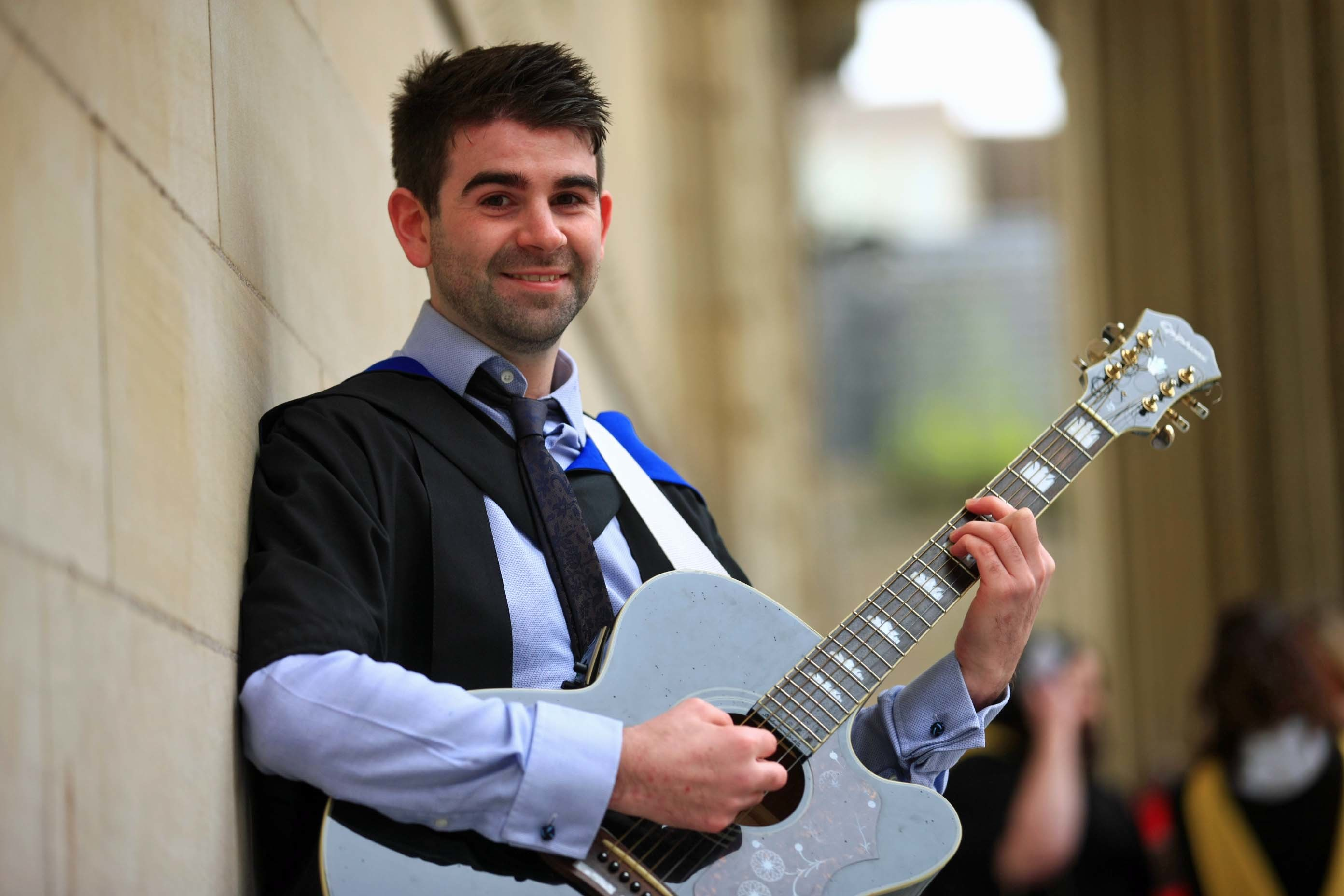 Adam with his guitar ahead of Thursday's graduation.