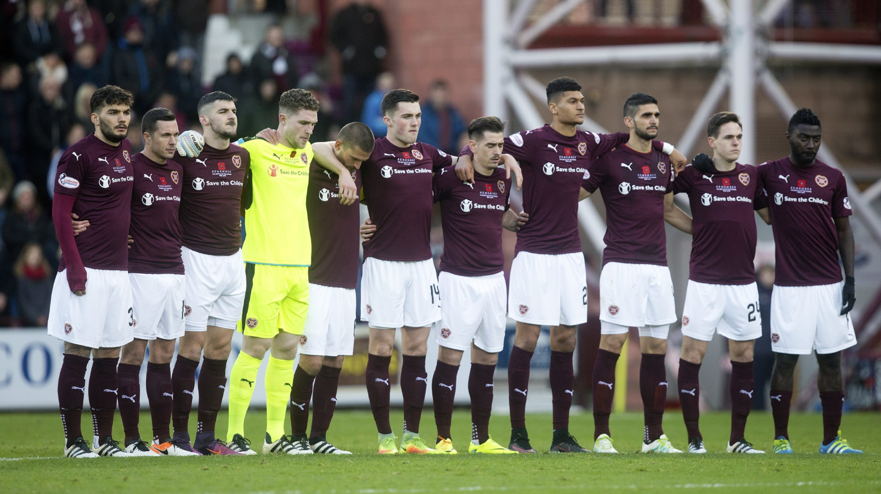 The Hearts players make their silent tribute.