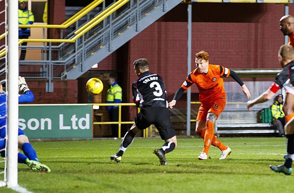 Simon Murray scores against Dunfermline.