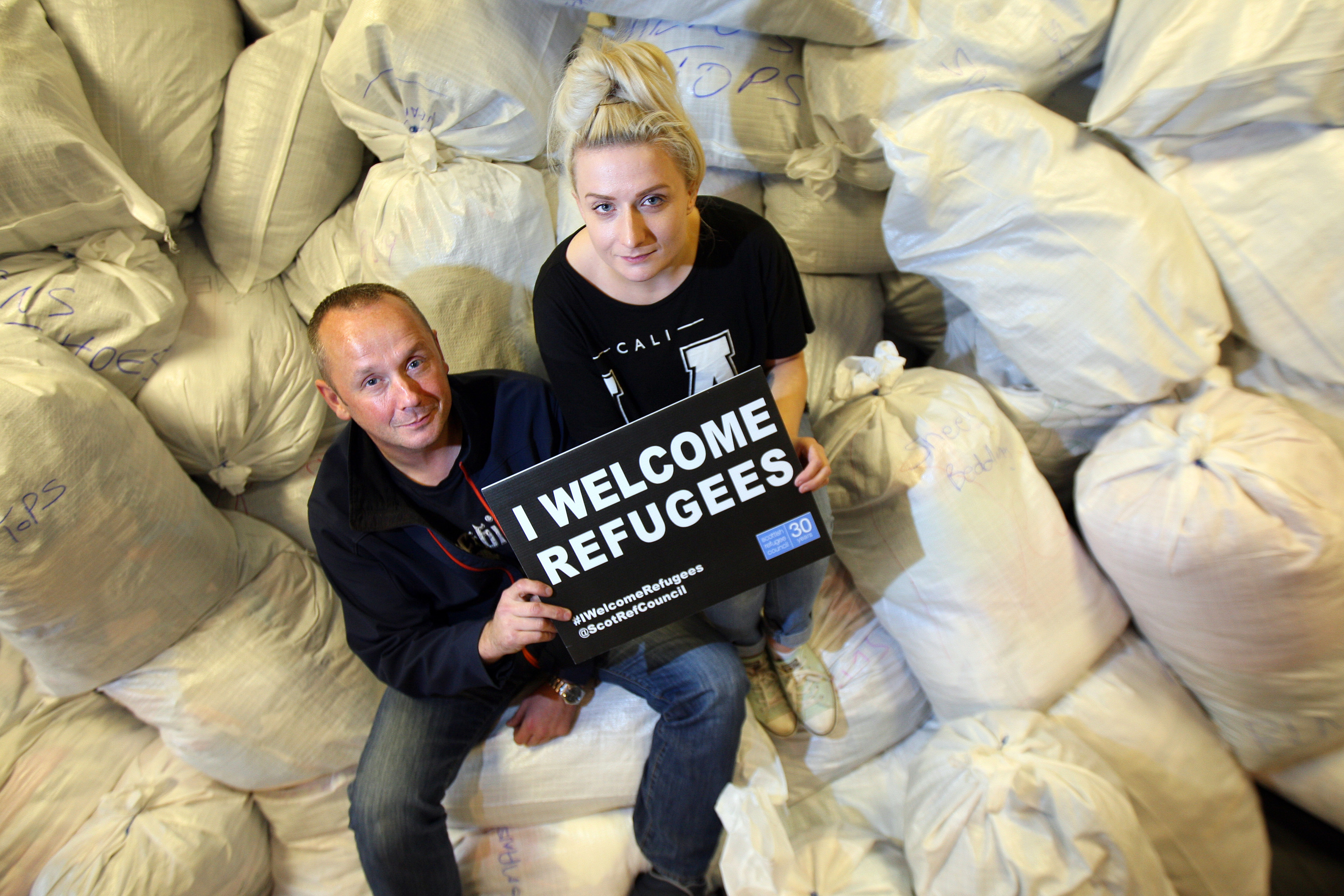 Mike Strachan and fellow volunteer Sammi Craig work hard to welcome refugees to Dundee