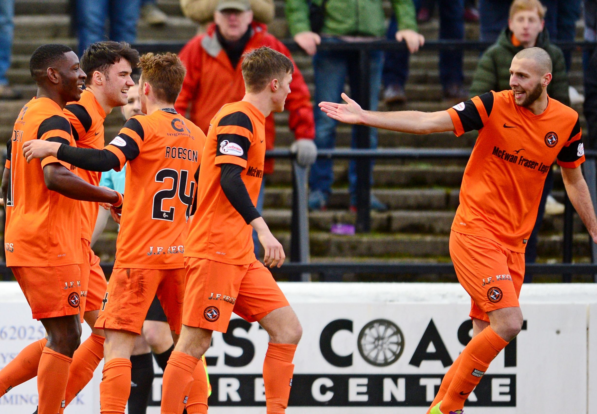Dundee United celebrate their winning goal at Ayr.