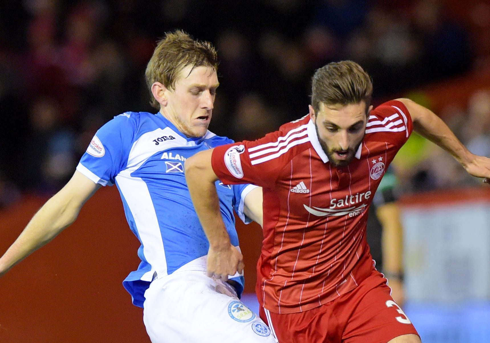 Blair Alston challenges Aberdeen's Graeme Shinnie.