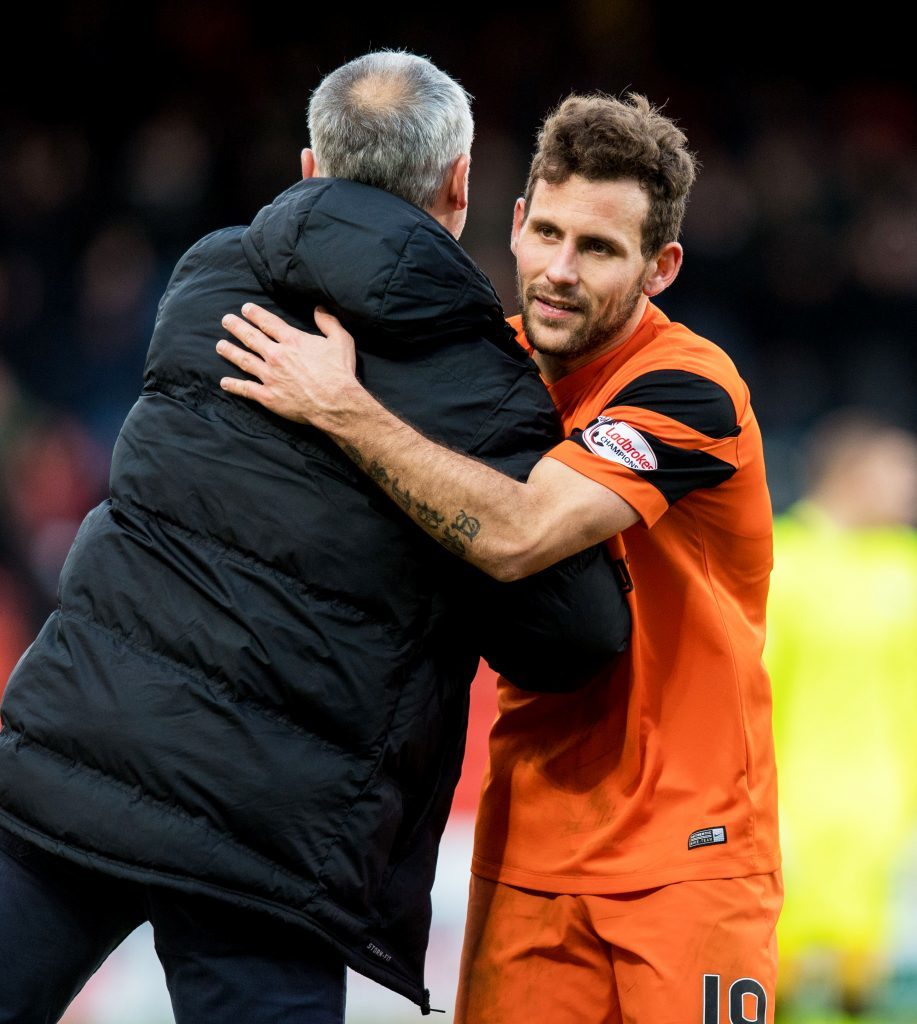 Tony Andreu and Ray McKinnon celebrate going top of the league.