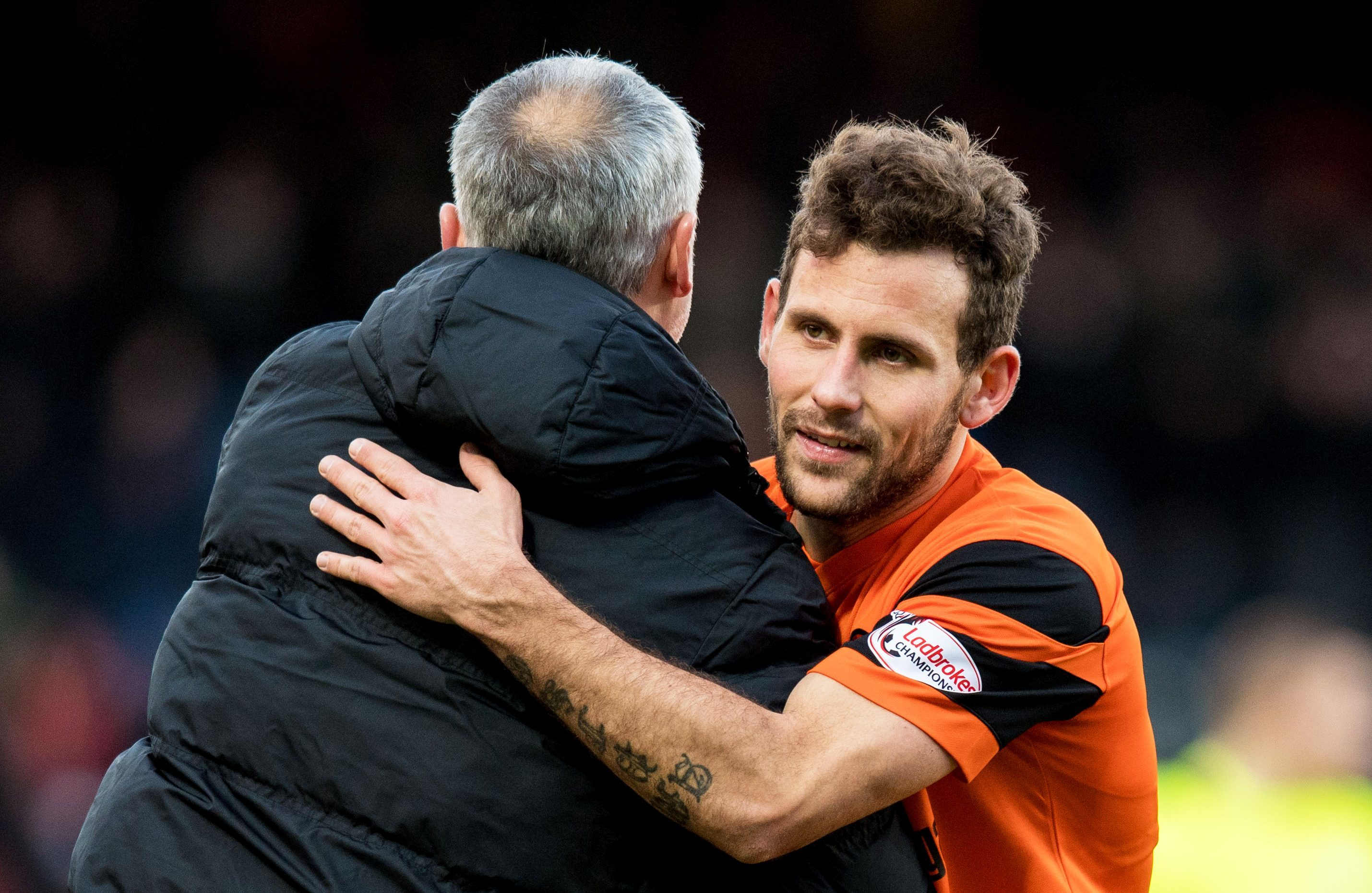 Tony Andreu gets a hug from manager Ray McKinnon.