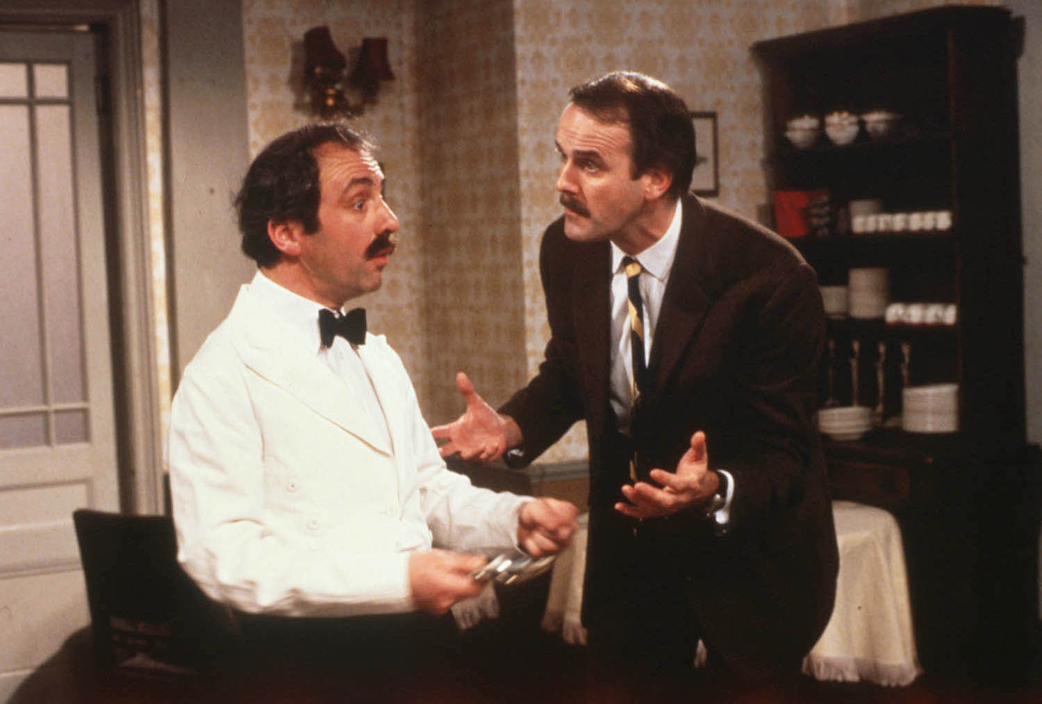 Andrew Sachs as Manuel, left, and John Cleese as Basil in BBC's Fawlty Towers.