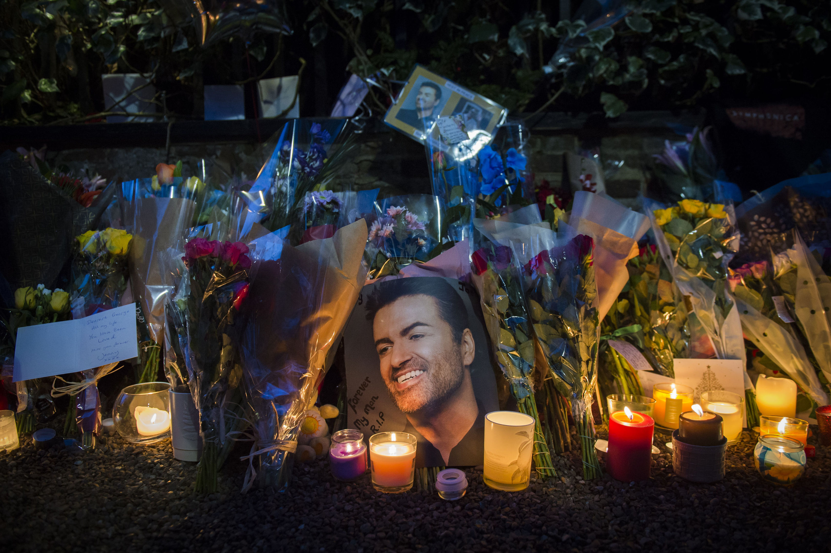 Tributes outside George Michael's house in Highgate, North London, UK, following the singer's death.