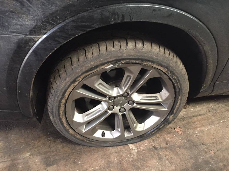 A battered alloy on the Audi