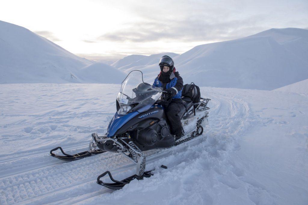 Sarah on a snowmobile safari across the artic desert.
