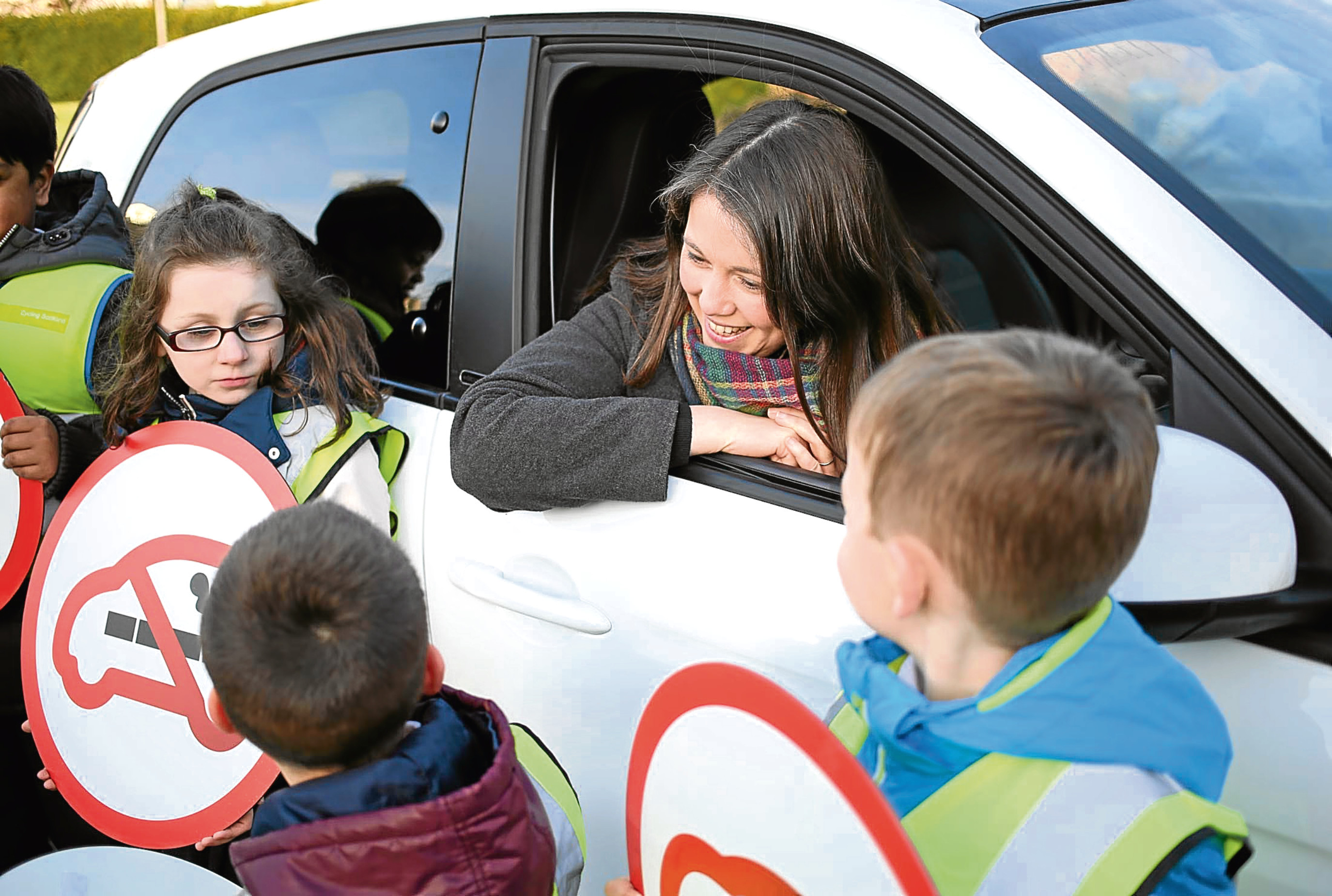 Aileen Campbell, Minister for Public Health and Sport, and some pupils from Edinburgh marked the day smoking in cars with children became illegal across Scotland in 2016