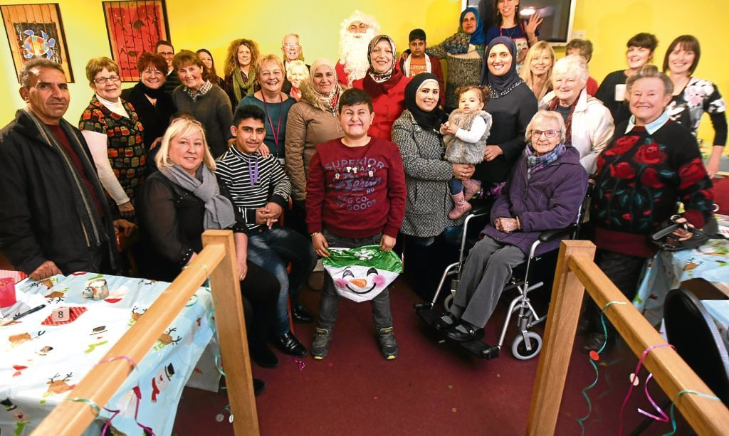 Syrian refugee families and the Polish Community get together to run a multicultural festive cafe in Arbroath. Alex worries about our reactions now compared to when we welcomed Italian immigrants such as his late neighbour into the country in the 1960s.