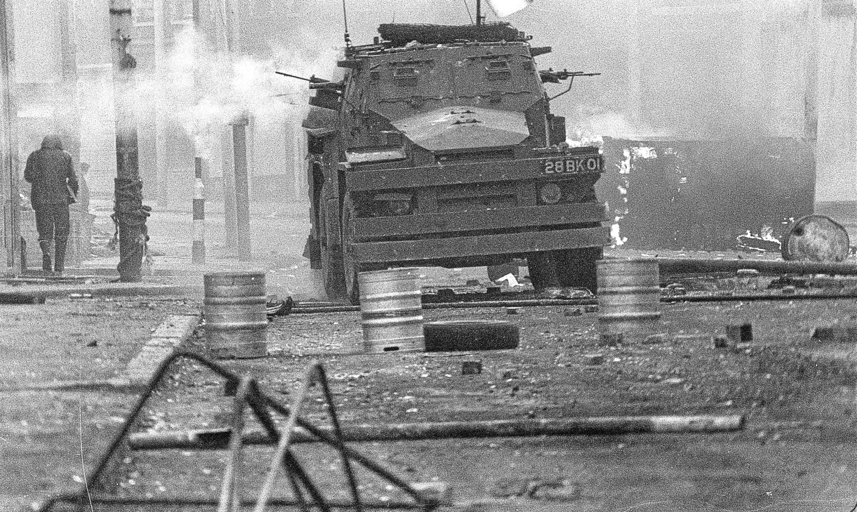 An armoured vehicle patrols Belfast following the shooting of Joe McCann.
