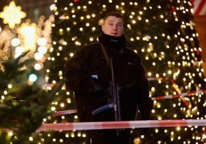 A policeman stands guard at the Christmas market.