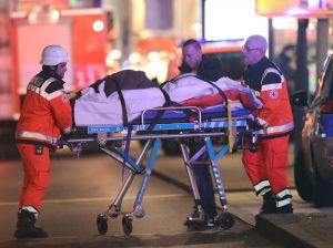 Paramedics remove one of the injured from the scene.