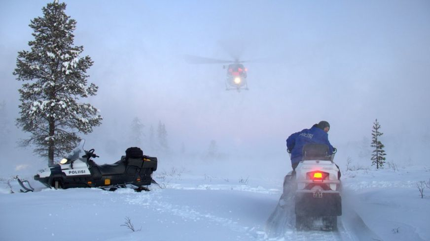 Finnish police survey the area