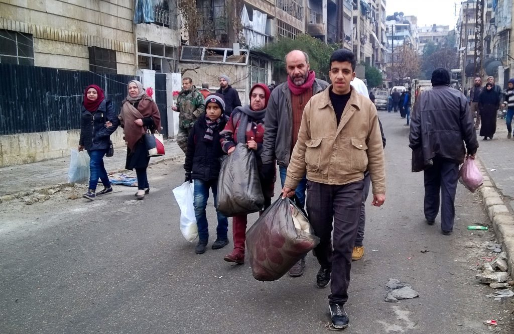 Civilians coming back to the ruined city of Aleppo, in a street in the eastern part of the city.