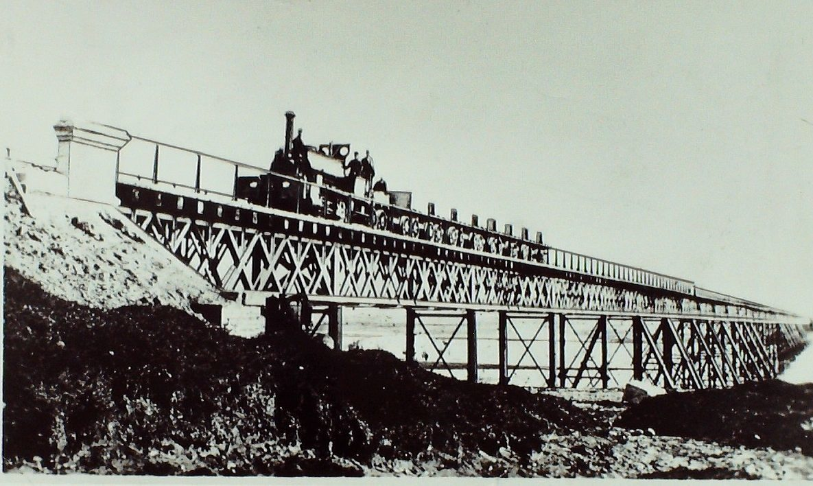 The first train on the Arbroath-Montrose line crossing the bridge at Montrose in 1883.