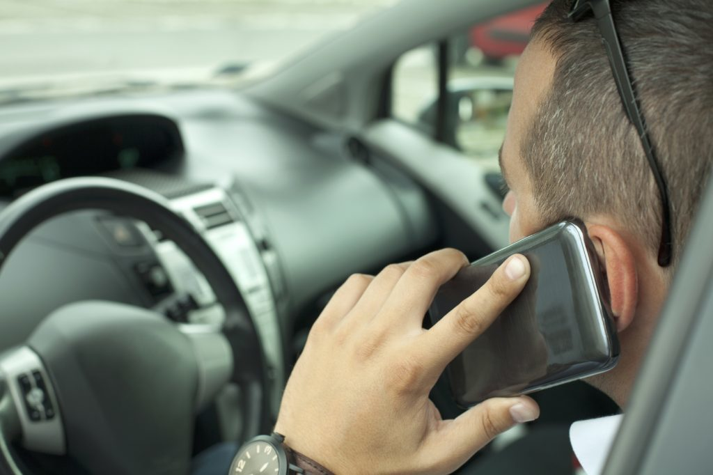 Drivers using contactless technology on their smart phones in drive through restaurants could risk  a fine.