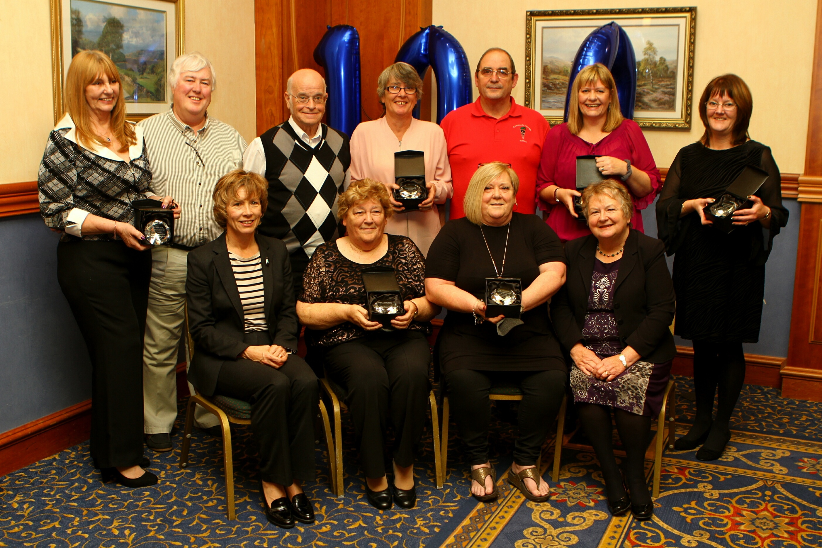 The long service award recipients at the Angus Council Foster Carers annual ceremony. Front L/R: Margo Williamson - Strategic Director, Sheena Thomson, Brenda Smith and Cllr Sheena Welsh - Convenor of Children & Learning. Back L/R: Susan and Rodney Ellis, Allan Thomson, Mary Towner, Colin Smith, Michelle Dewar and Jill Hamilton.