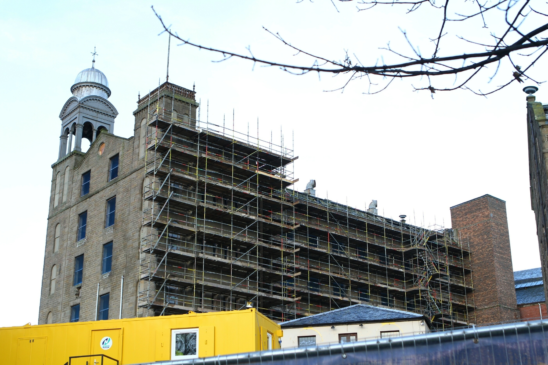 The Lower Dens Works has scaffolding erected in readiness for the start of work to convert it into an Indigo hotel.