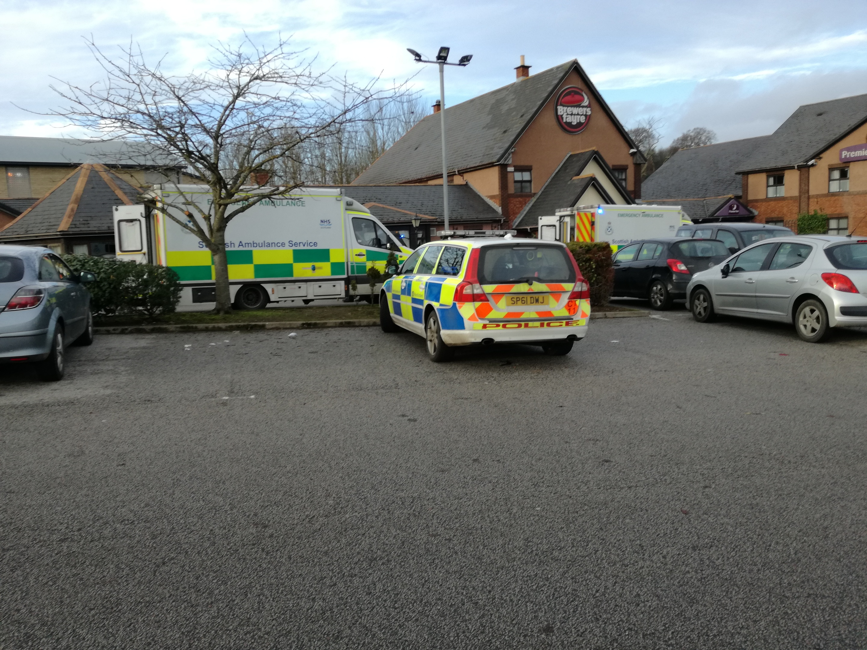 Emergency services responded after an elderly driver crashed into a wall.