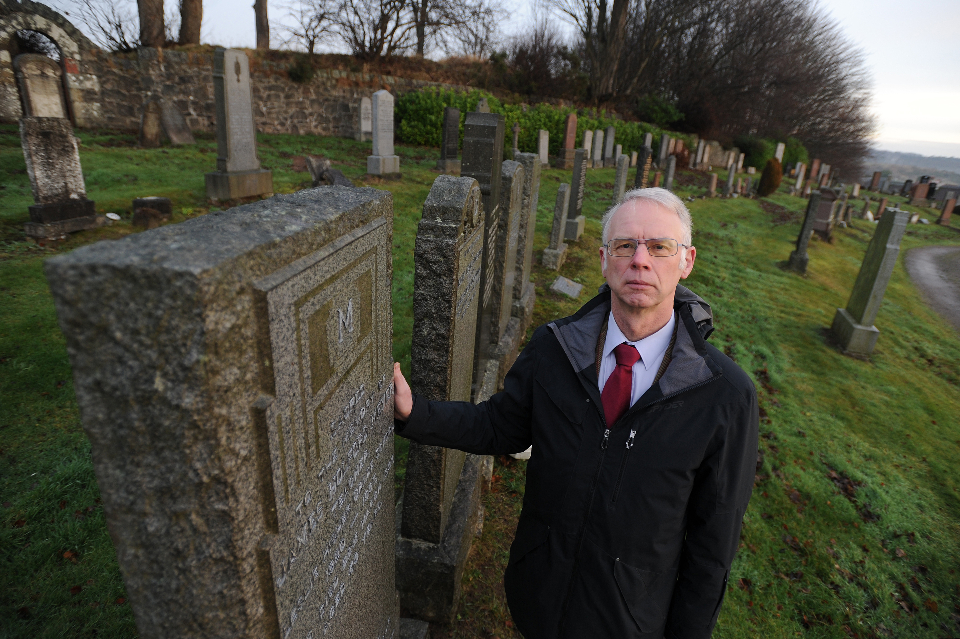 Councillor John Wincott looks around Leslie Cemetery.