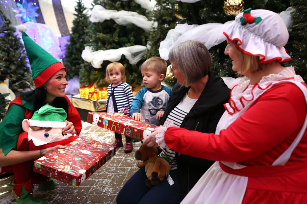 Gayle (the elf) with Poppy and Finn Killen and grandmother Jennifer Hall.