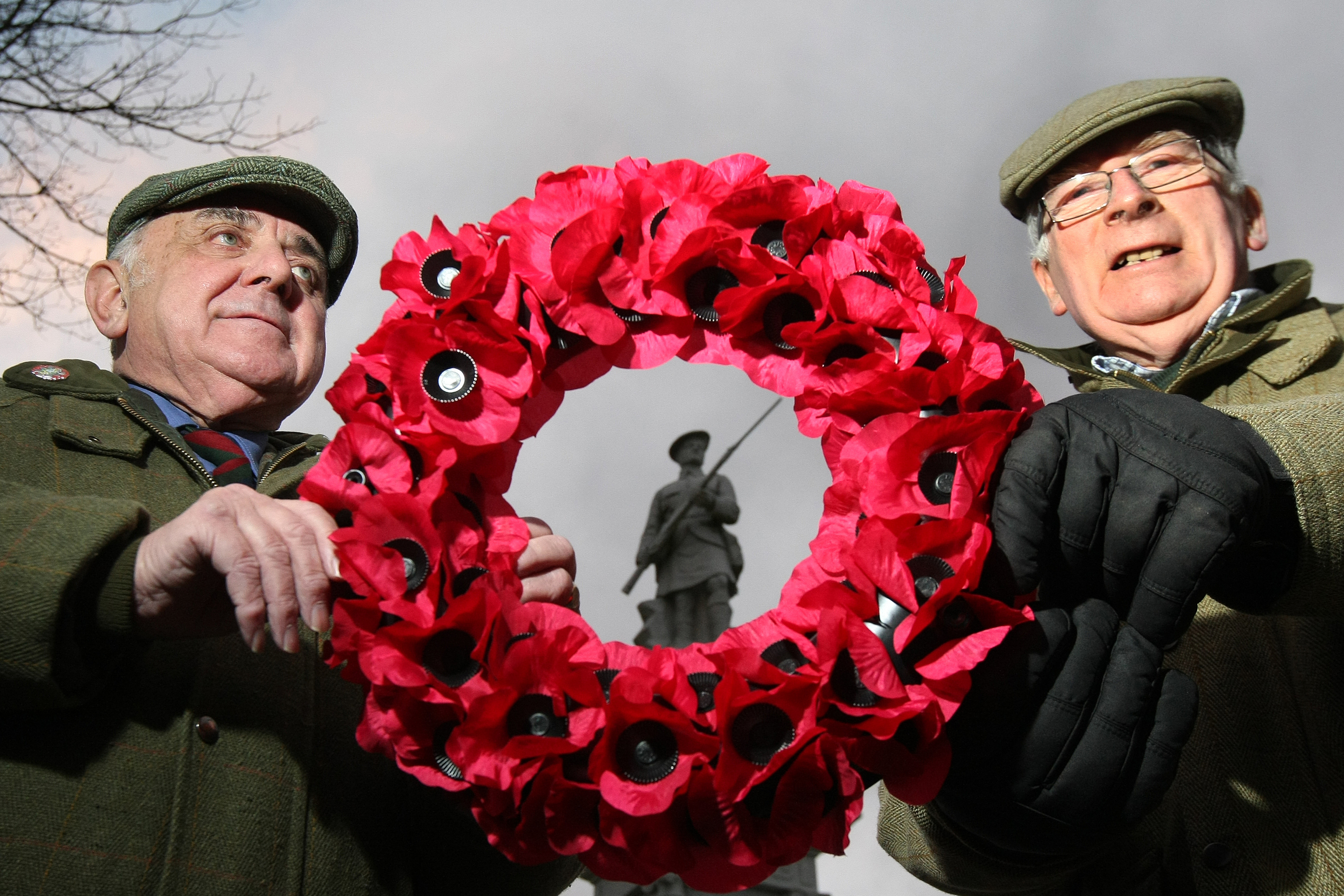 Cllr Ronnie Proctor and Jim Ritchie with a wreath at the Kirriemuir war memorial in previous years.