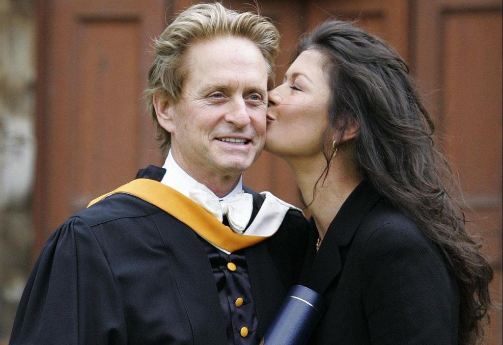 Kirk Douglas' son - Hollywood star Michael Douglas - receives a kiss from wife Catherine Zeta Jones after collecting his honorary degree at Younger Hall in St Andrews in 2006