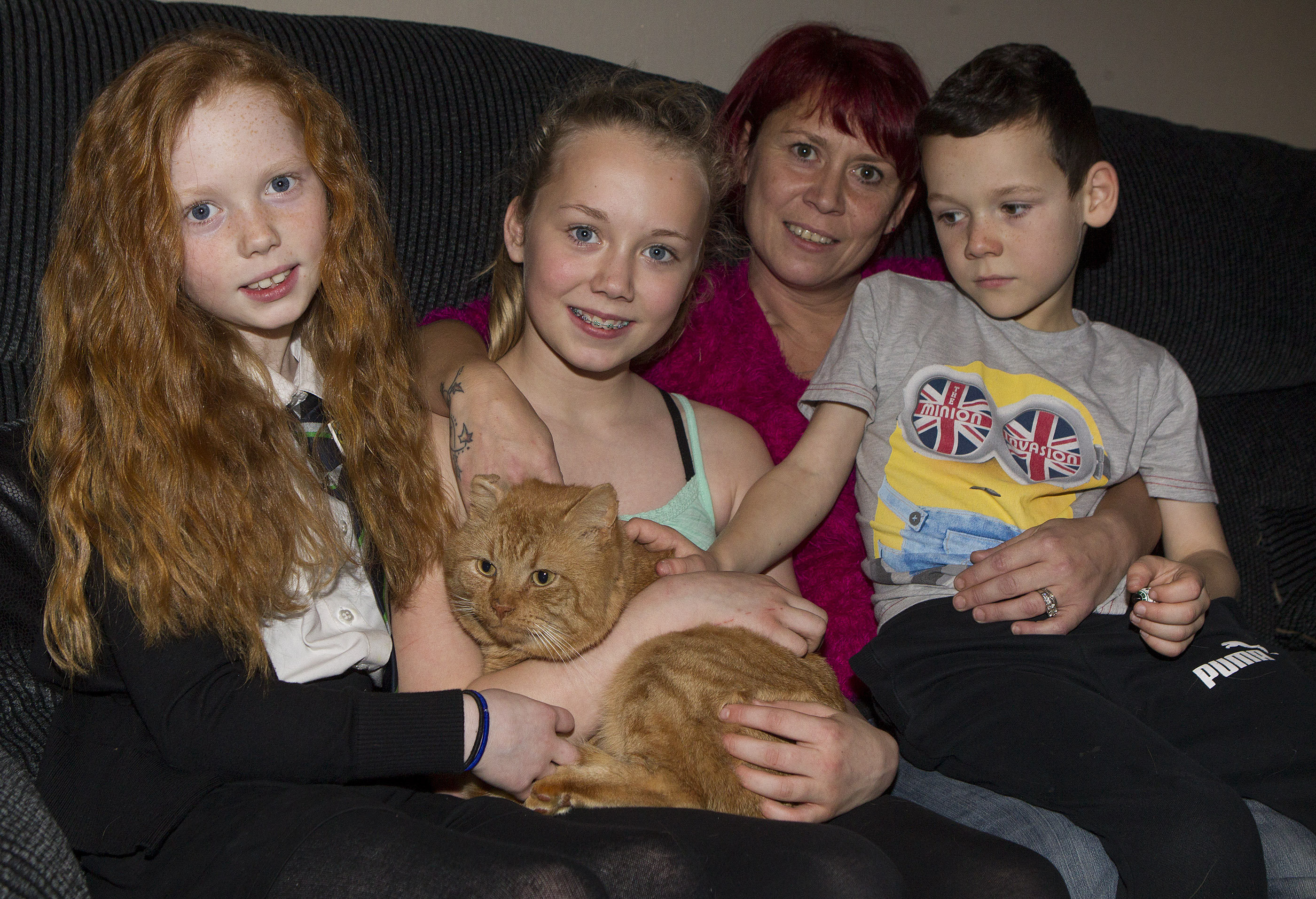Mandy Hynd with her children, Sophie 9, Kaylah 11 and Jack 8, who are delighted to have Alfie the ginger tom cat home.