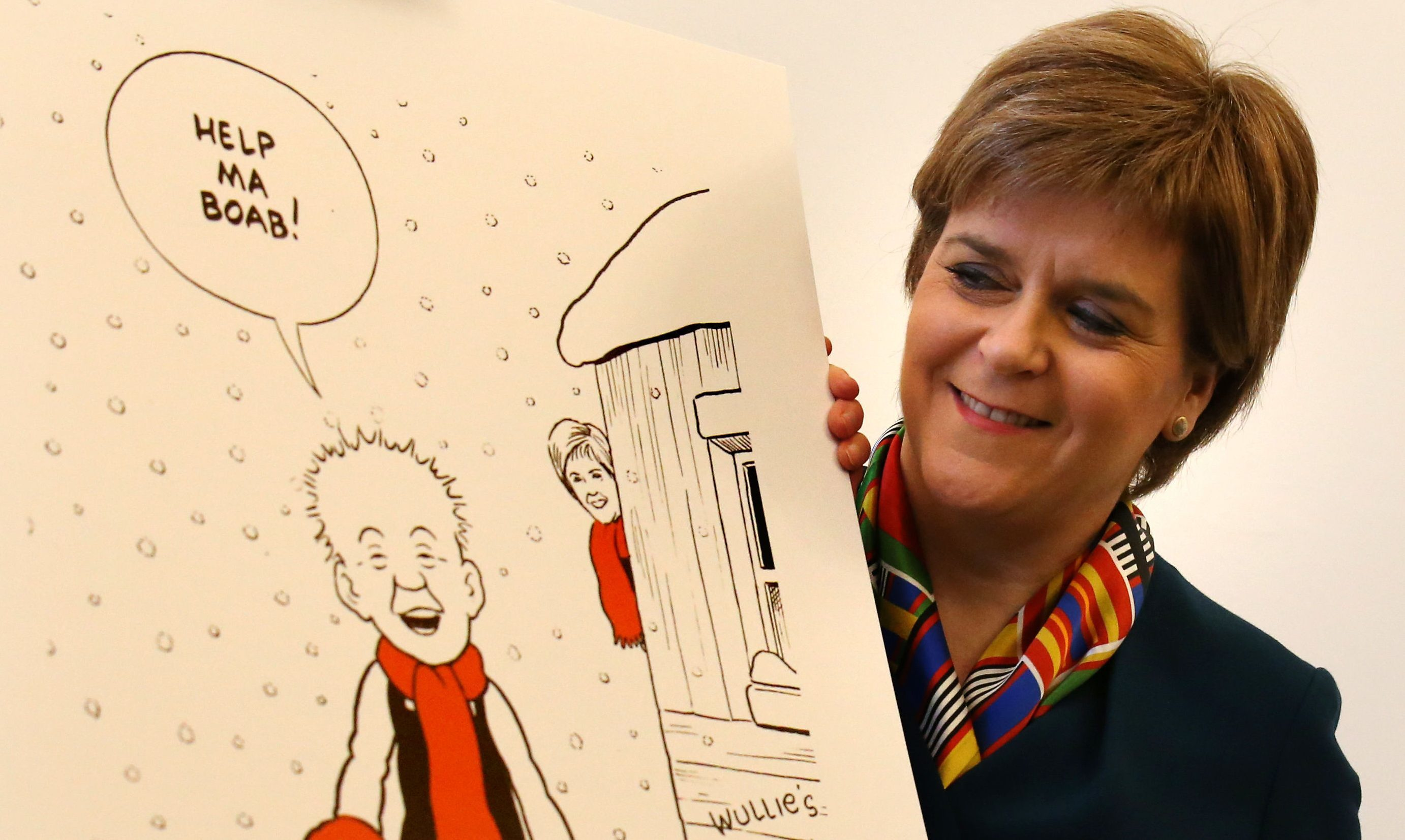 Nicola Sturgeon unveiling her Oor Wullie-themed Christmas card.