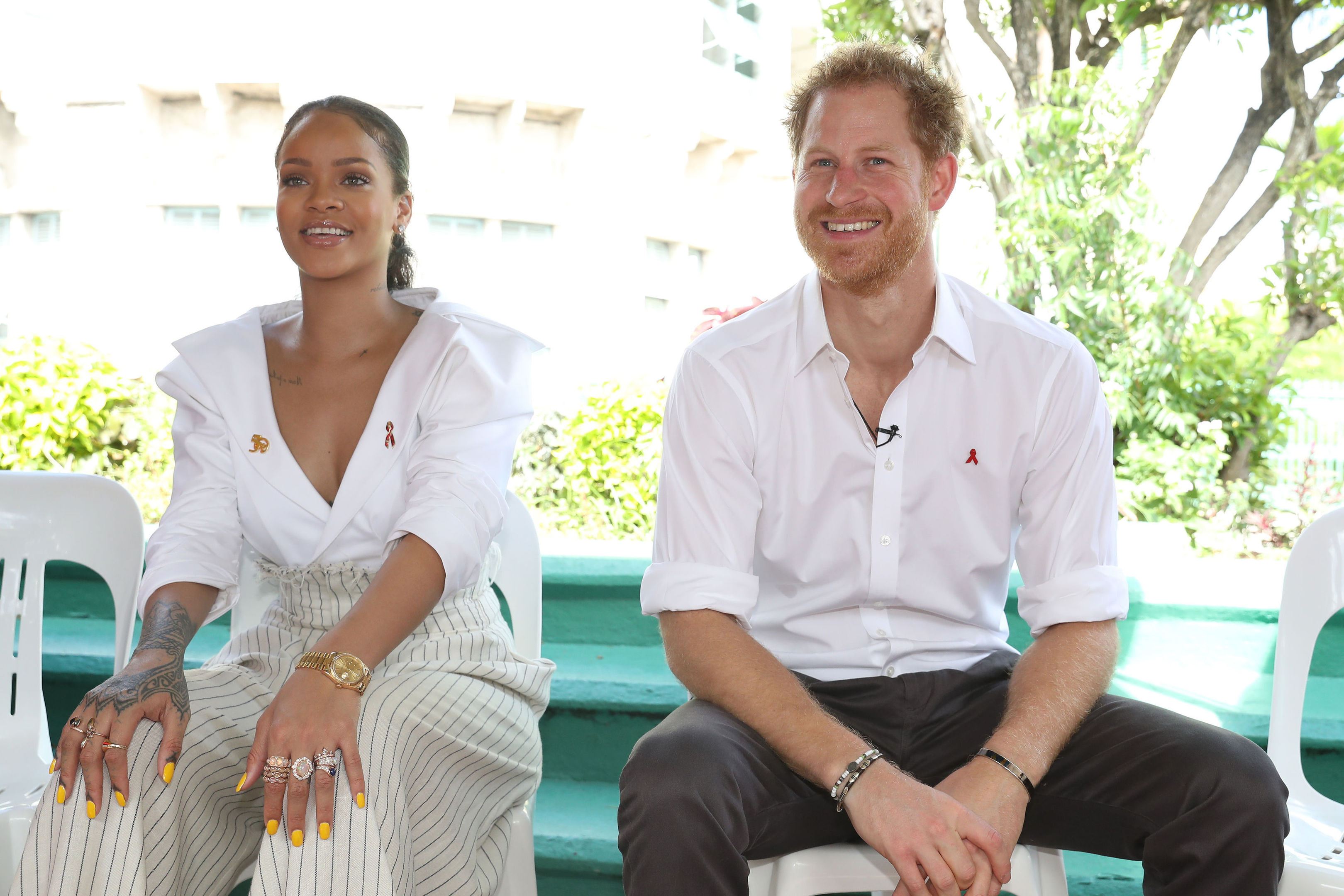 Snger, Rihanna and Prince Harry on stage, at the 'Man Aware' event held by the Barbados National HIV/AIDS Commission in Bridgetown, Barbados, during his tour of the Caribbean.