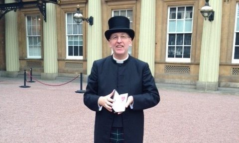 Rev John Duncan was presented with his medal at Buckingham Palace