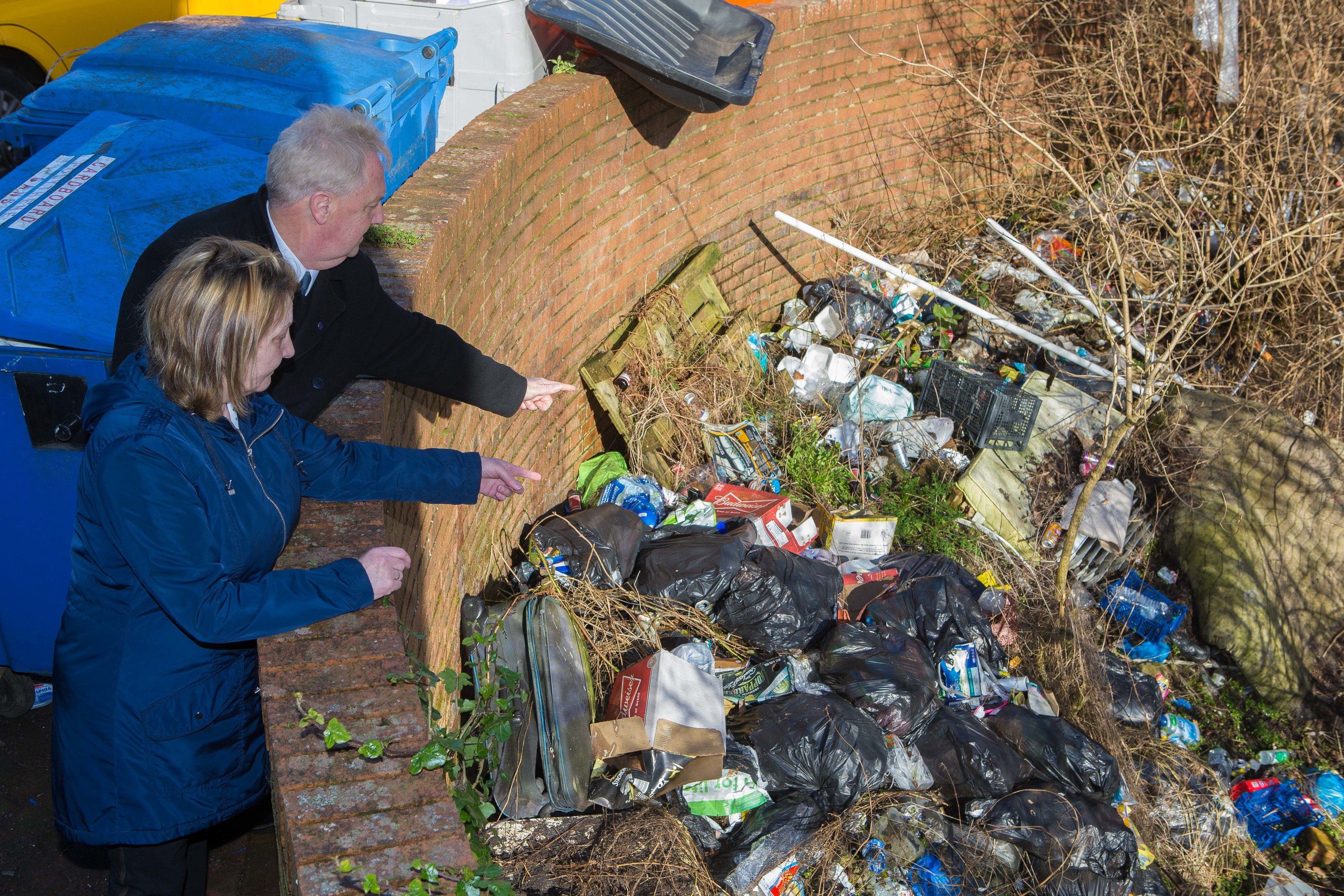 Councillor John O'Brien and local resident Phamie Campbell at the source of the rat infestation which has taken over the block in Wellsley Road, Methil.