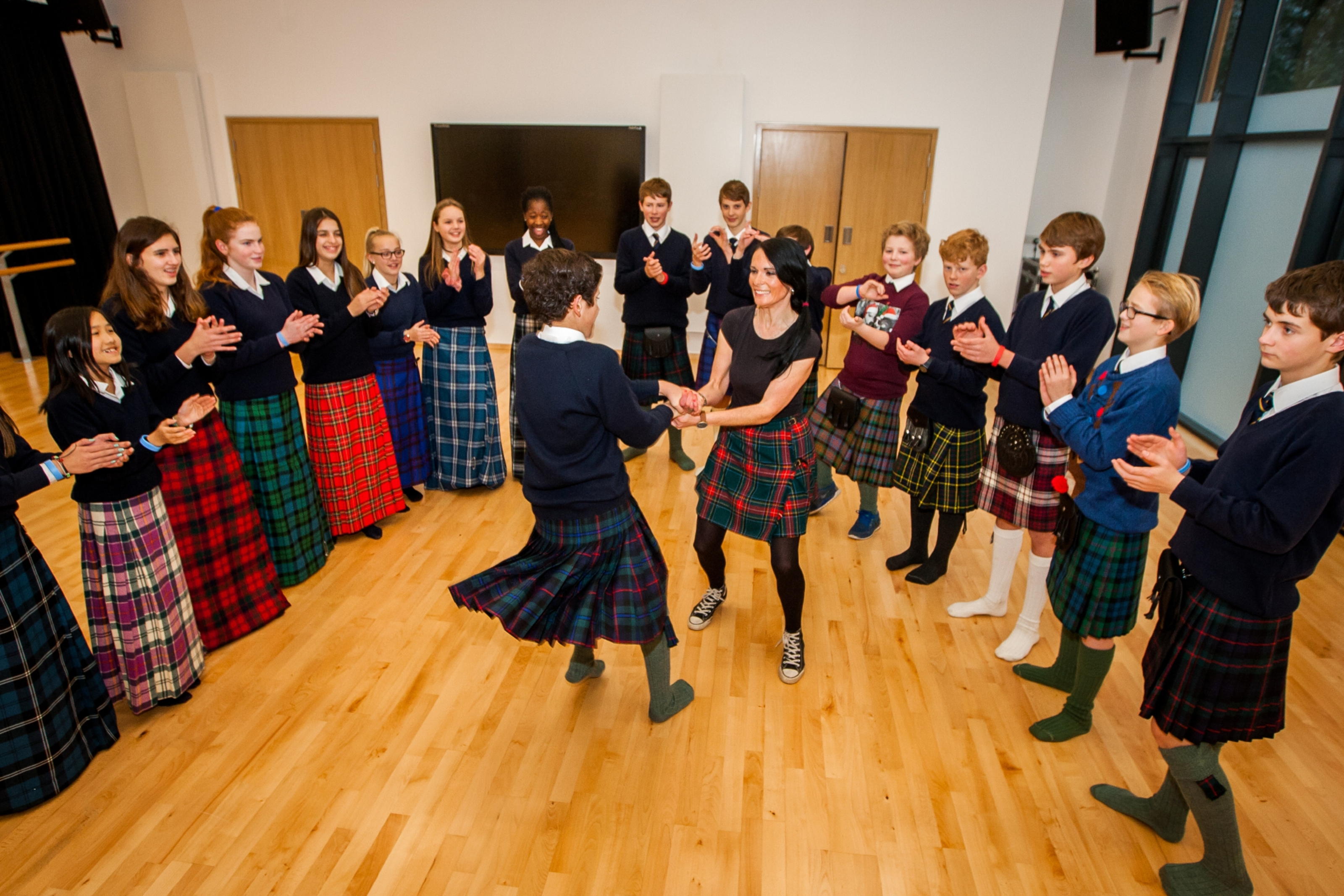 Gayle Ritchie spins with Juan Mianna during a social dancing class at Strathallan School.