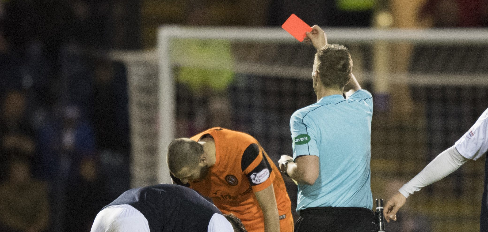 Lewis Toshney is red carded.