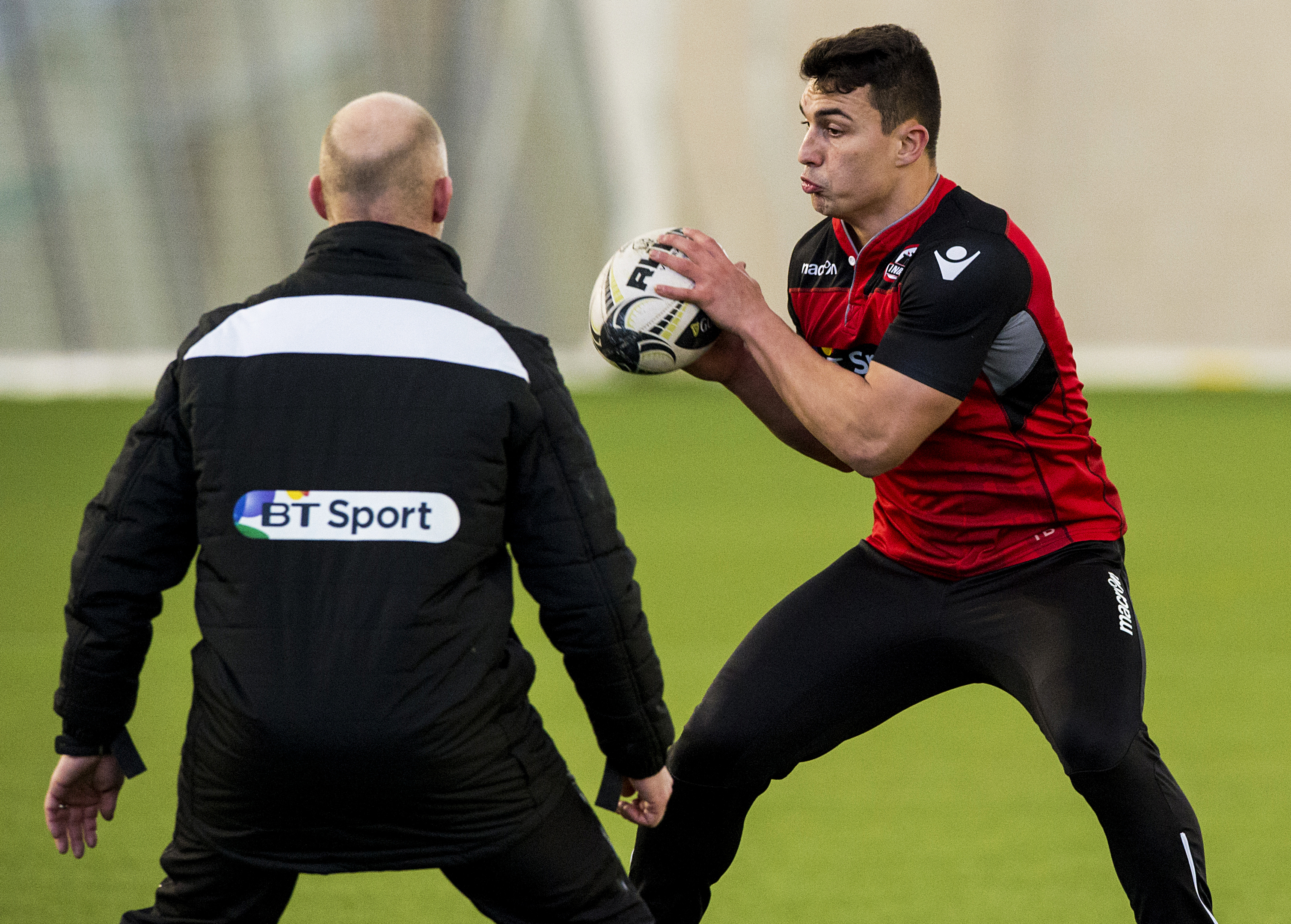 Damien Hoyland takes on head coach Duncan Hodge at Edinburgh's practice session at Oriam.