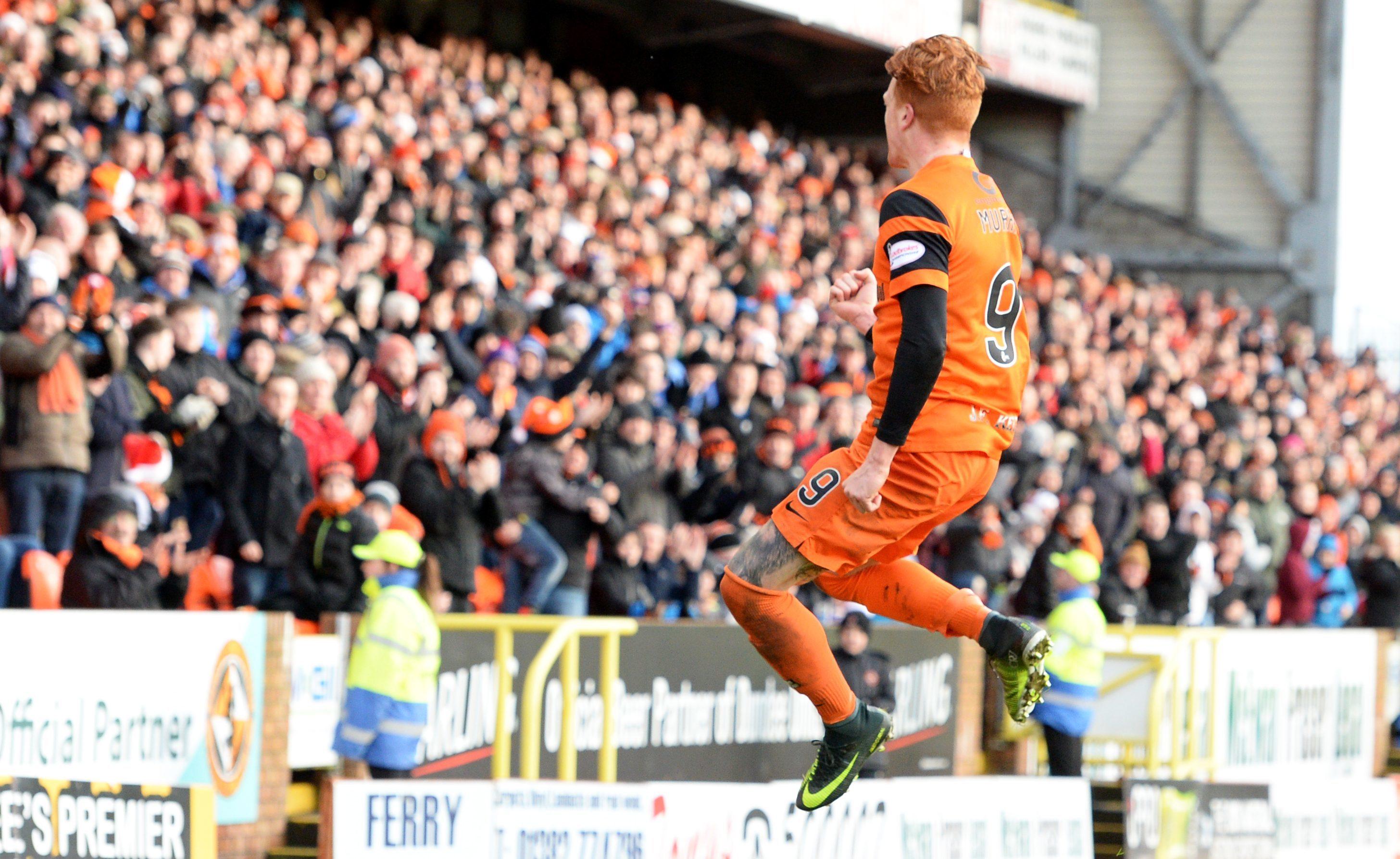 Simon Murray celebrates his goal.
