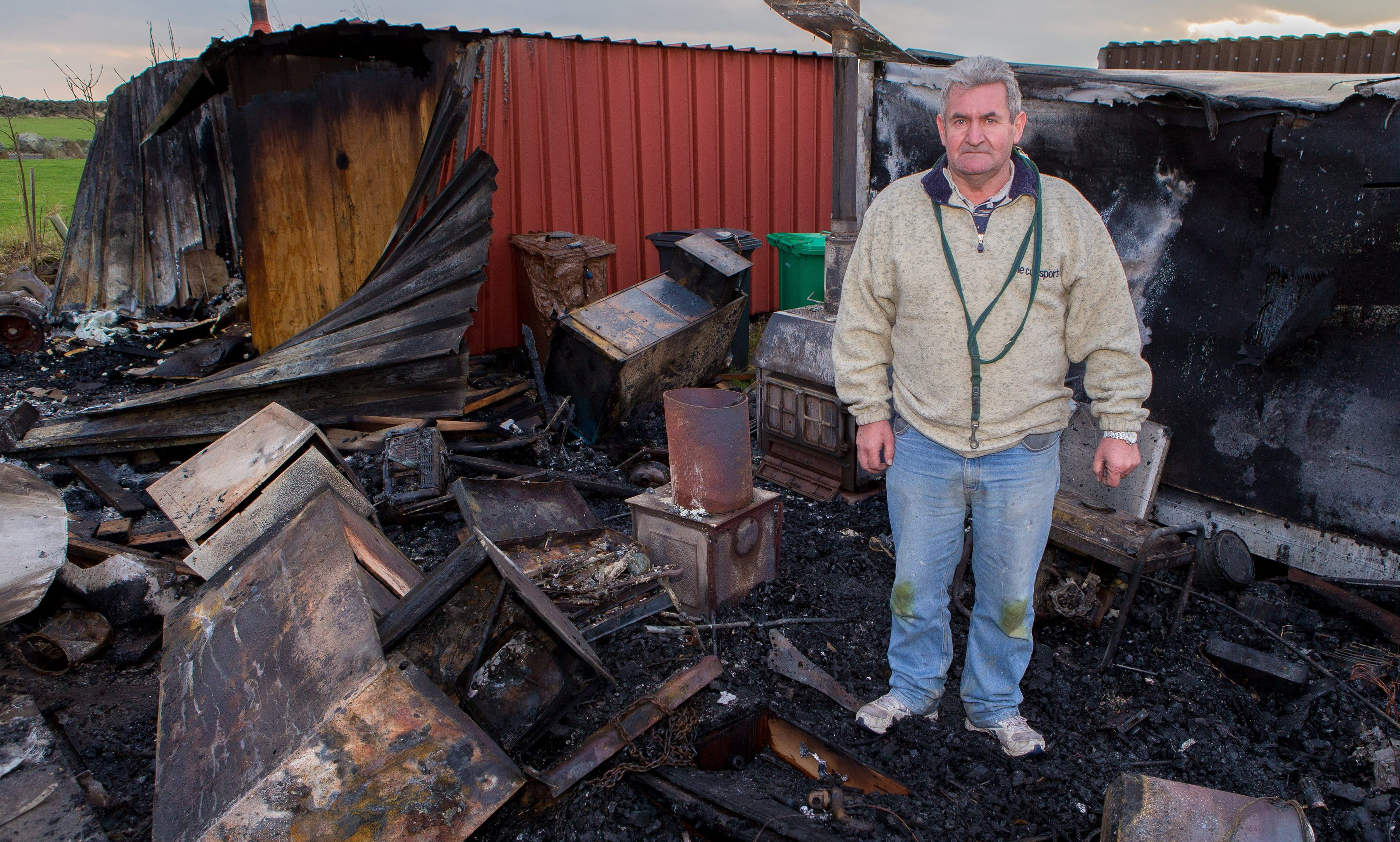Roy Warrender, 60, in what's left of his shed.
